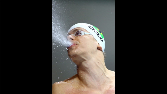 Cesar Cielo of Brazil reacts after finishing in the men