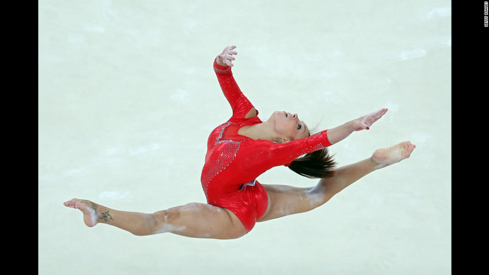 Italy's Vanessa Ferrari competes in the floor exercise in the artistic gymnastics women's individual all-around final.