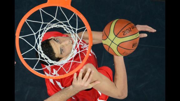 Tunisian center Salah Mejri scores during the men
