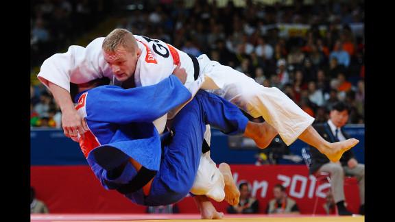 Dimitri Peters, in white, of Germany and Jevgenijs Borodavko of Latvia compete in the men