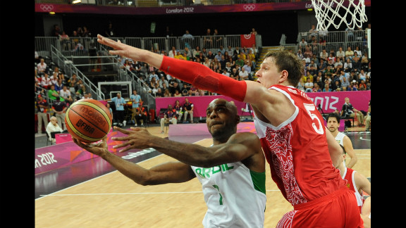 Brazilian forward Larry Taylor, left, tries to get past Russian center Timofey Mozgov, right, during the men