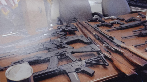 Police found an arsenal of weapons in the home of a Maryland man accused of making threats against his workplace.