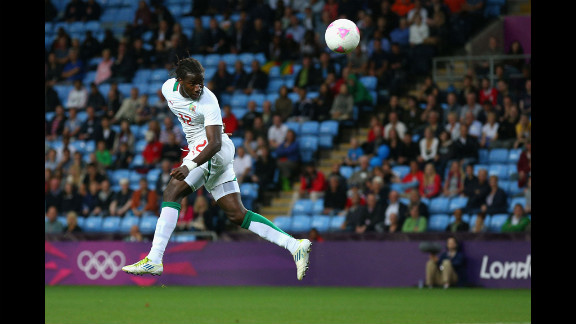 Ibrahima Balde of Senegal heads the ball during the men
