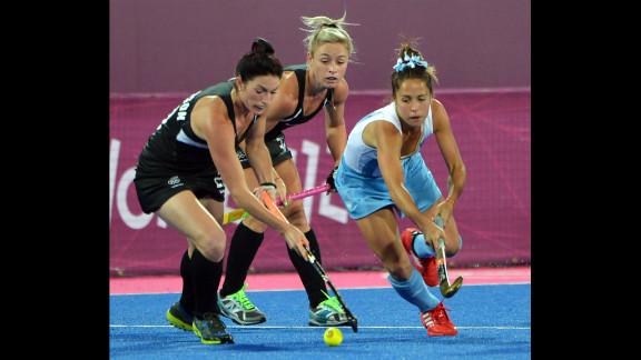 Ella Gunson, left, and Anita Punt, center, of New Zealand challenge Rocio Sanchez Moccia, right, of Argentina during the women