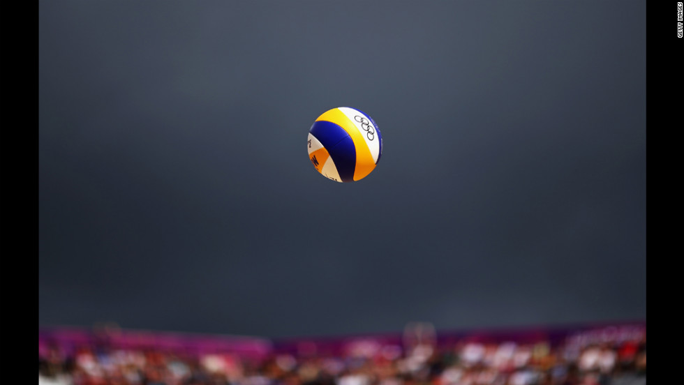 The ball gets served during a men's beach volleyball match between Switzerland and Poland.
