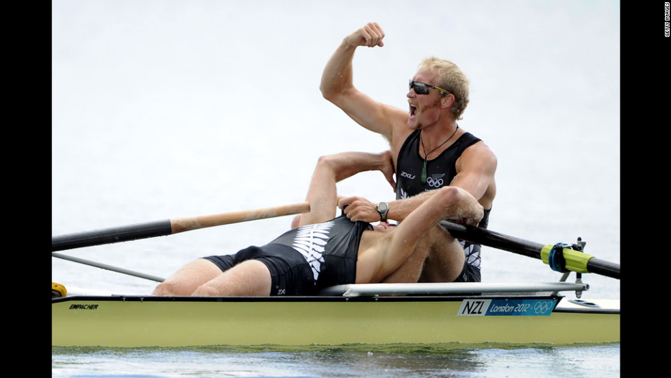 Hamish Bond and Eric Murray of New Zealand celebrate after winning gold in the men's pair at the Olympic rowing regatta.