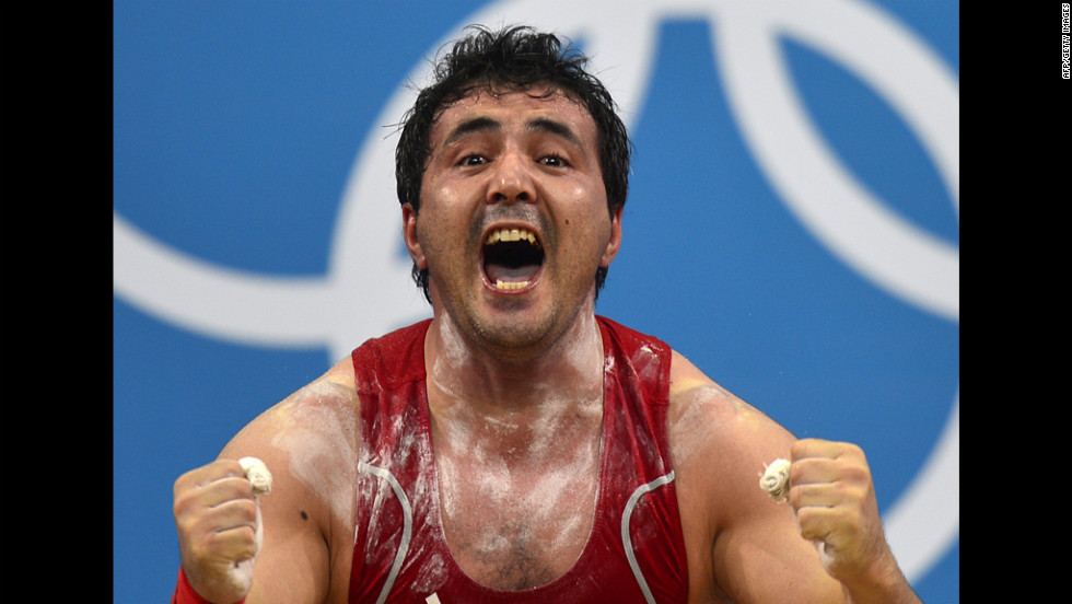 Uzbekistan's Sherzodjon Yusupov celebrates during the men's 85-kilogram weightlifting event.