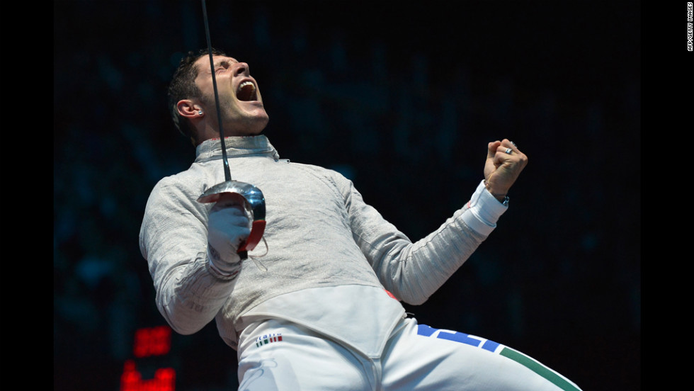 Italy's Aldo Montano celebrates gaining the qualifying point against Aliaksandr Buikevich of Belarus during the men's saber team quarterfinals.
