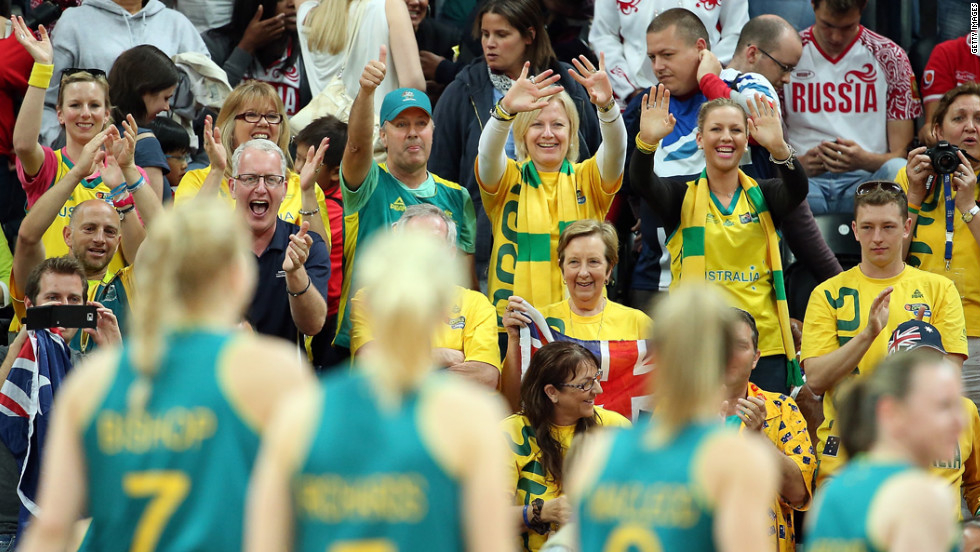 Fans cheers Australia's players as they leave the court after defeating Russia in a women's basketball preliminary round.