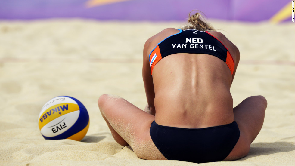Sophie van Gestel of the Netherlands takes a breather during a women's beach volleyball match against Brazilian opponents.