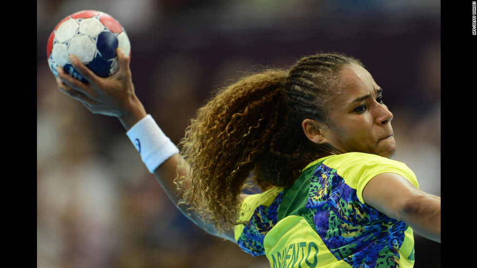 Brazil's Alexandra Nascimento shoots during a women's preliminary handball match against Russia.