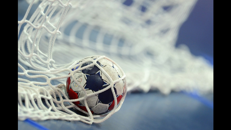A ball appears in the net of a goal during the women's preliminary handball match between Russia and Brazil.