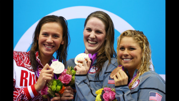 Left to right: Silver medalist Anastasia Zueva of Russia, gold medalist Missy Franklin of the United States and bronze medalist Elizabeth Beisel of the United States on the podium during the medal ceremony for the women
