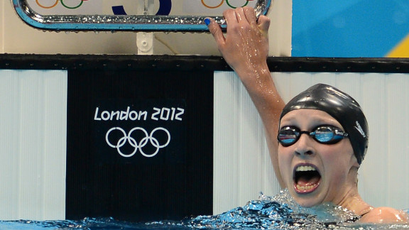Fifteen-year-old Katie Ledecky reacts after winning the women