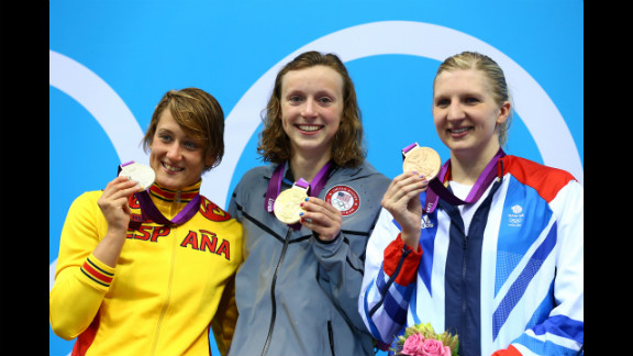 Left to right: Silver medallist Mireia Belmonte Garcia of Spain, gold medalist Katie Ledecky of the United States and bronze medalist Rebecca Adlington of Great Britain on the podium during the medal ceremony for the women