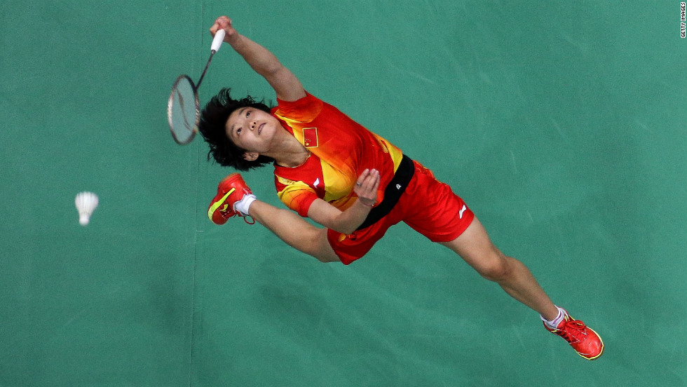 Xin Wang of China competes in the women's singles badminton semifinal at Wembley Arena.