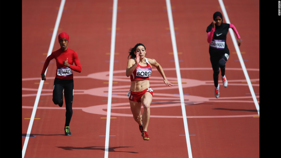 "Oman's Shinoona Salah Al-Habsi, left, and Diane Borg of Malta compete in the women's 100-meter heats. Check out photos from <a href=""http://www.cnn.com/2012/08/04/worldsport/gallery/olympics-day-8/index.html"" target=""_blank"">Day 8 of the competition </a>on Saturday, August 4."