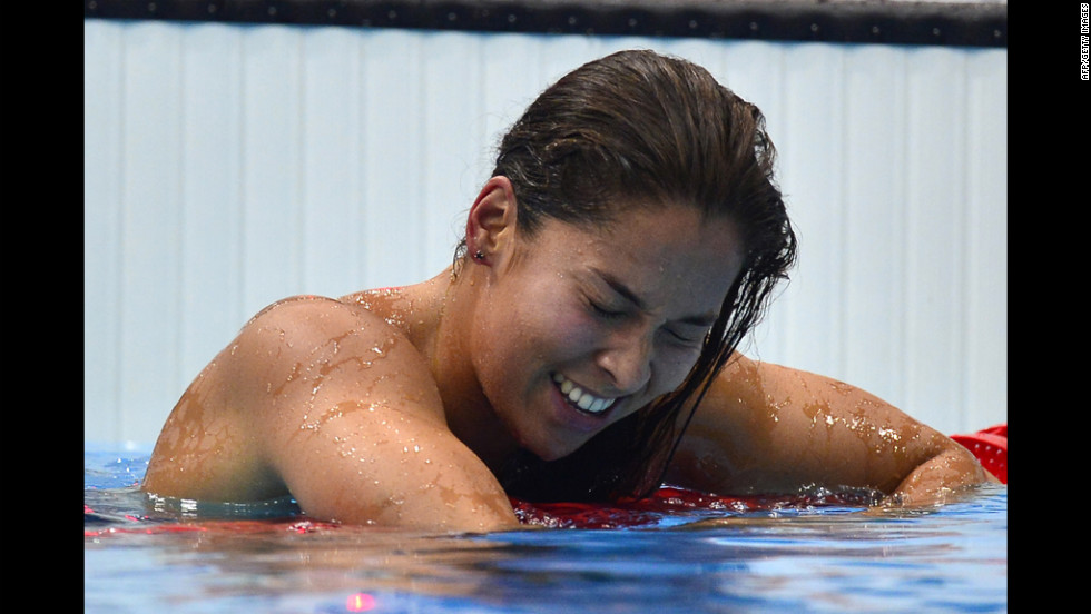 The Netherlands' Ranomi Kromowidjojo reacts to her gold medal win in the women's 100-meter freestyle final swimming event.