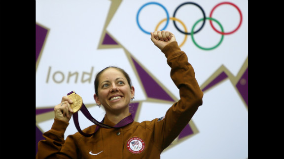 Gold medalist Jamie Lynn Gray of the United States celebrates on the podium after winning the 50-meter rifle 3 positions women