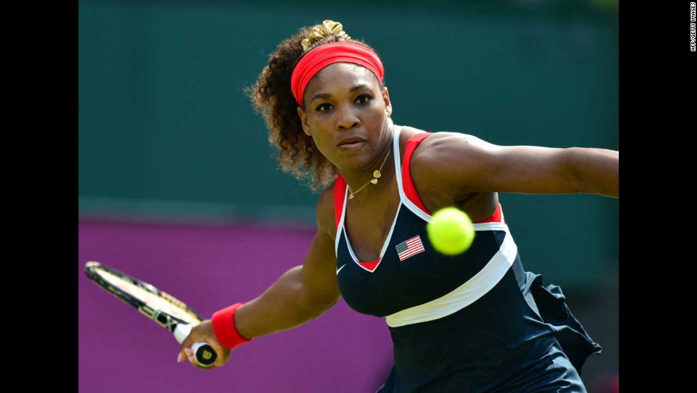 Serena Williams hits a return to Russia's Maria Sharapova during the women's singles tennis final.