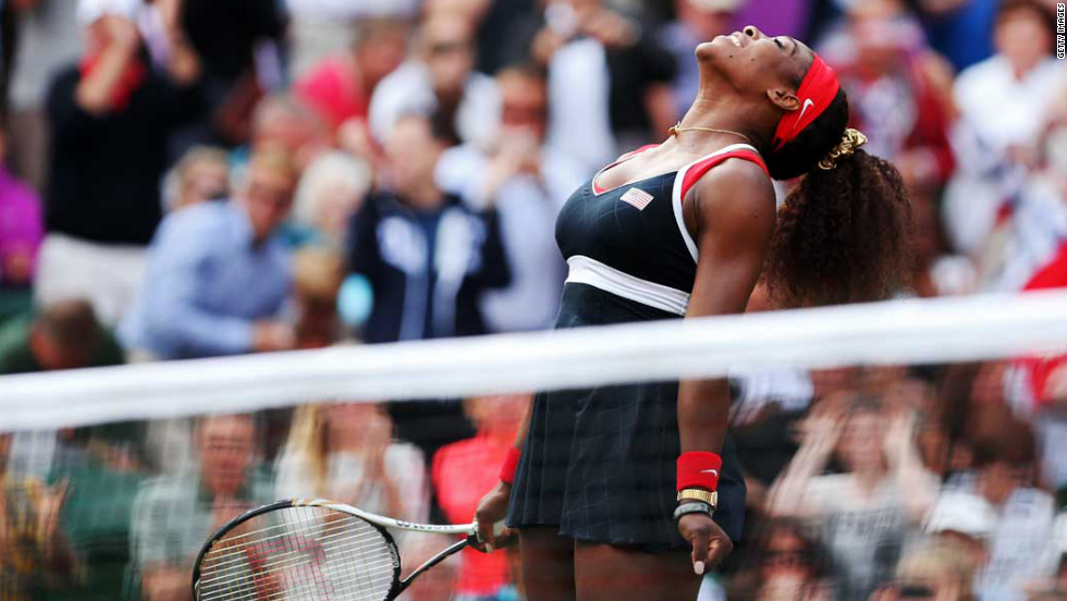 Serena Williams reacts after defeating Maria Sharapova of Russia to win the gold medal in women's singles tennis at Wimbledon. Williams won 6-0, 6-1.