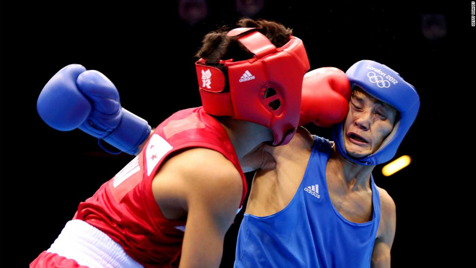 Left to right: Mark Barriga of the Philippines and Birzhan Zhakypov of Kazakhstan in action during the men's light fly (46-49 kilogram) boxing.