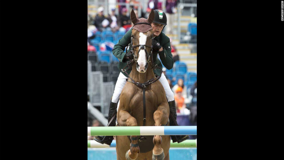 Ireland's Bill Twomey, on Tinka's Serenade, competes in the first individual show jumping qualifier.