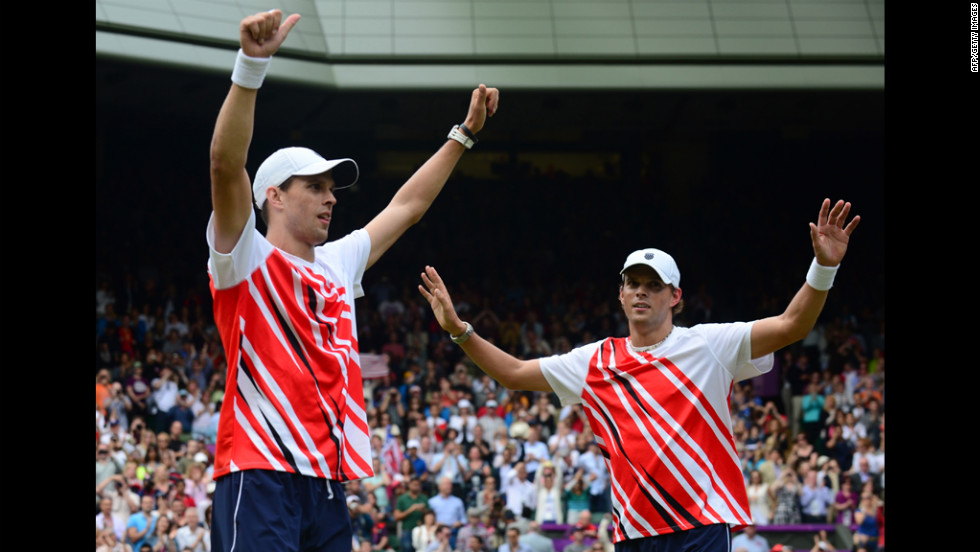 Mike Bryan, left, and Bob Bryan celebrate after defeating France's Michael Llodra and Jo-Wilfried Tsonga to win gold in the men's doubles event.