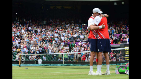 Brothers Mike Bryan, left, and Bob Bryan embrace after defeating France
