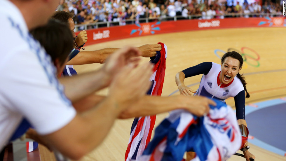 Dani King of Great Britain celebrates winning the gold medal and breaking the world record in women's team pursuit track cycling.