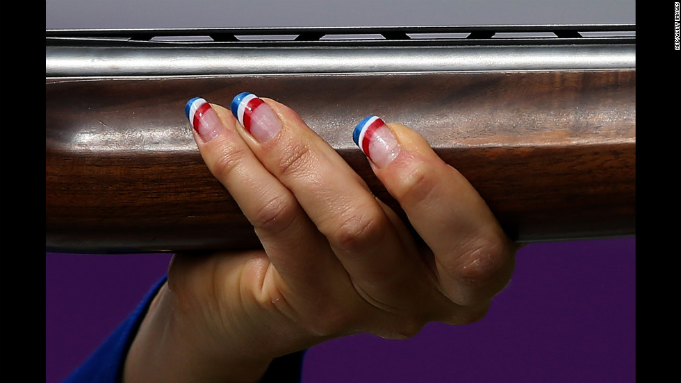 France's Delphine Reau competes in the women's trap shooting final at the Royal Artillery Barracks in London. She won the bronze medal.