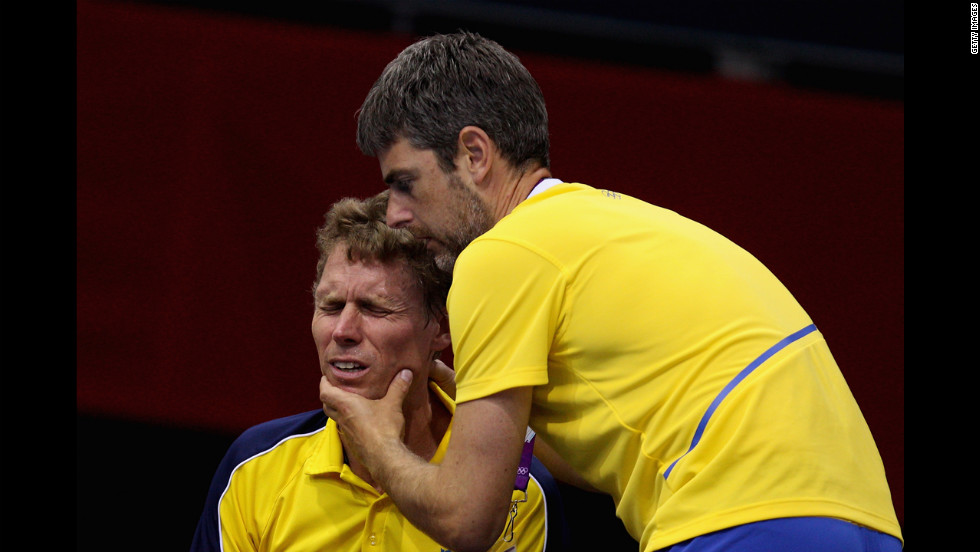 A teammate urges Jorgen Persson, left, of Sweden to focus during a table tennis match.