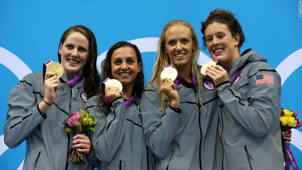Left to right: Gold medalists Missy Franklin, Rebecca Soni, Dana Volmer, and Allison Schmitt pose during the medal ceremony for the women's 4x100-meter medley relay on Saturday, August 4.