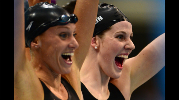 Dana Vollmer, left, and Missy Franklin react after winning gold in the women