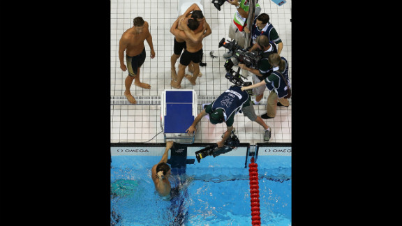 Clockwise: Matthew Grevers, Brendan Hansen, Michael Phelps and Nathan Adrian react to winning gold in the men