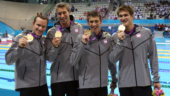 Left to right: Brendan Hansen, Matthew Grevers, Michael Phelps and Nathan Adrian pose following the medal ceremony for the men