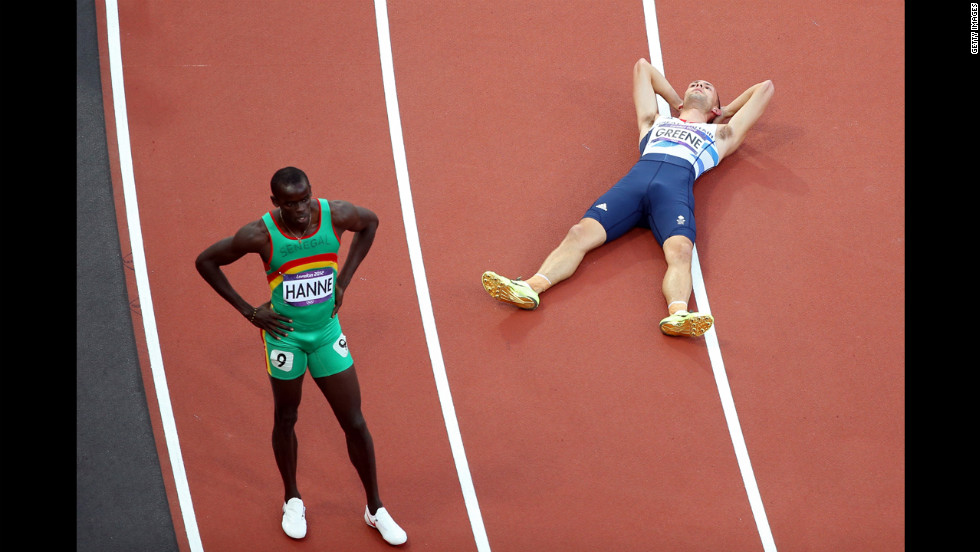 Left to right: Mamadou Kasse Hanne of Senegal and David Greene of Great Britain after competing in the men's 400-meter hurdles semifinal. Greene advanced; Hanne did not.