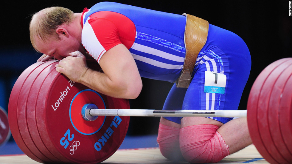 Andrey Demanov of Russia celebrates during the men's 94 kilogram weightlifting final.