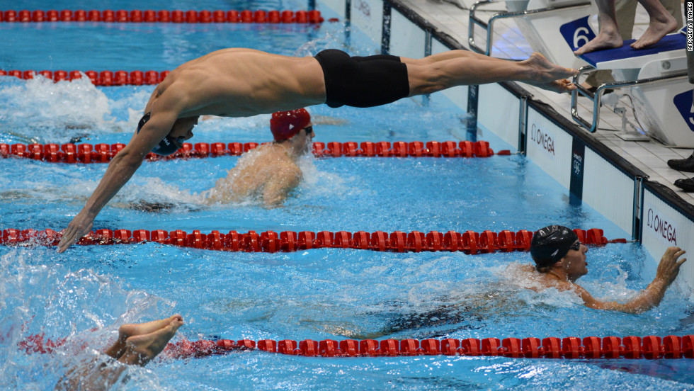 Michael Phelps, center, competes in the men's 4x100-meter medley relay final.