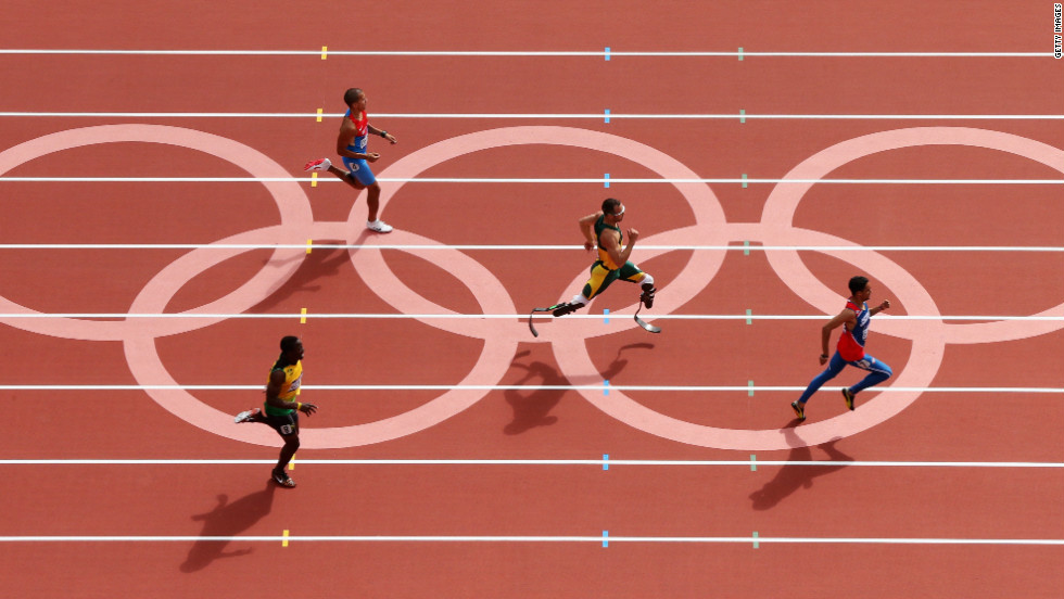 Rusheen McDonald of Jamaica, Luguelin Santos of the Dominican Republic, Oscar Pistorius of South Africa and Maksim Dyldin of Russia compete in the first round of the men's 400-meter on Saturday.