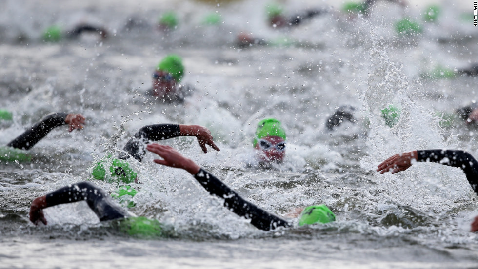 Athletes swim the first leg of the women's triathlon during Saturday.