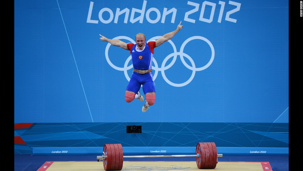 Andrey Demanov of Russia celebrates during the men's 94kg weightlifting final.
