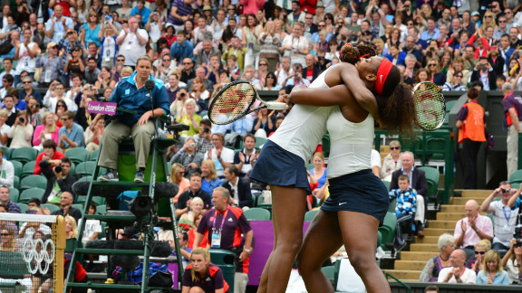 Venus Williams, left, and Serena Williams embrace after winning the women