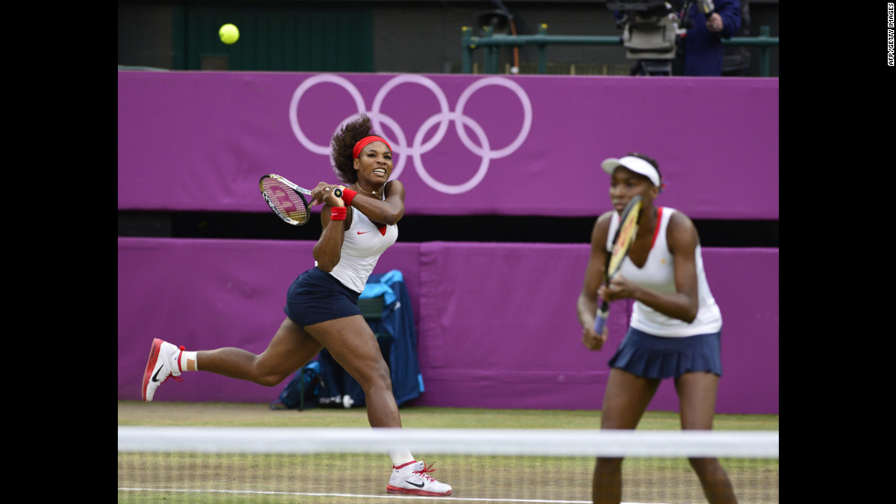 Serena Williams, left, and Venus Williams play the Czech Republic's Andrea Hlavackova and Lucie Hradecka at the women's doubles gold medal match.