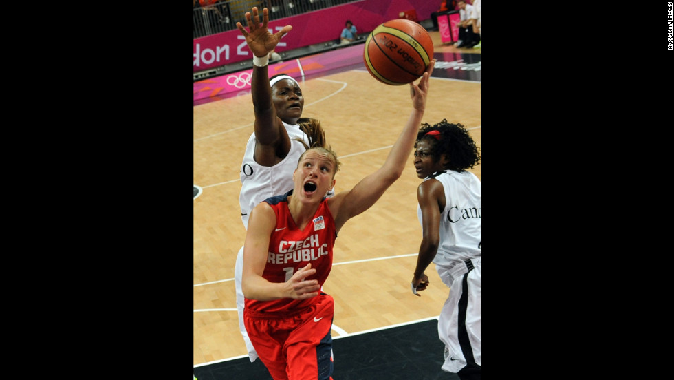 Czech Republic guard Katerina Elhotova, center, attempts a shot during a women's basketball  preliminary round match against Angola.