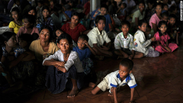 People displaced by sectarian violence sit at a monastery used as a temporary shelter in Sittwe, Myanmar.