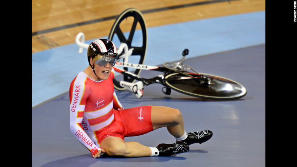 Denmark's Lasse Norman Hansen crashes during the men's 15-kilometer scratch race cycling event at the London Velodrome.