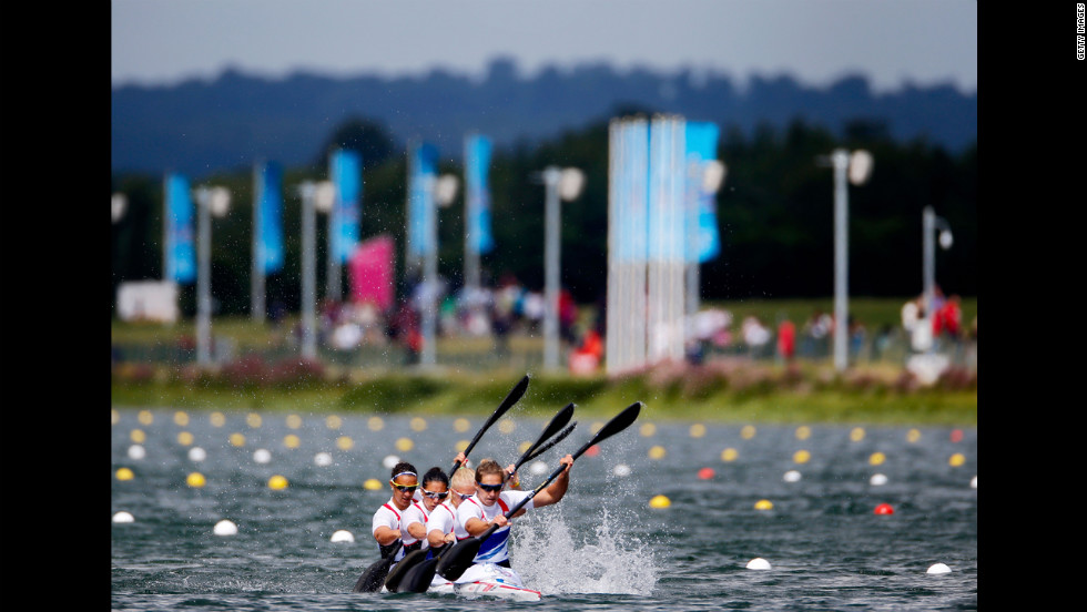The Great Britain team races downriver in the women's kayak four 500-meter sprint semifinal in Windsor.