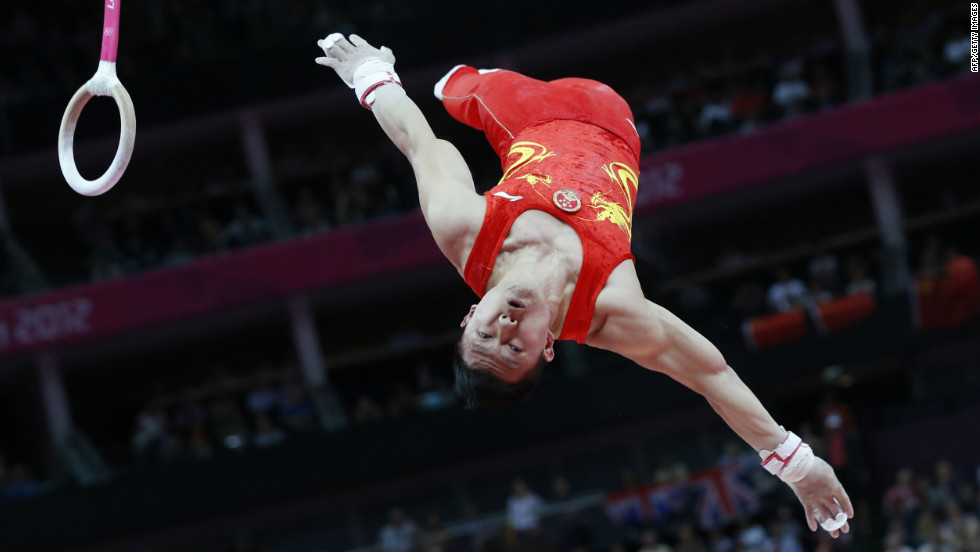 Chen Yibing of China dismounts to win the silver medal in the men's rings final.