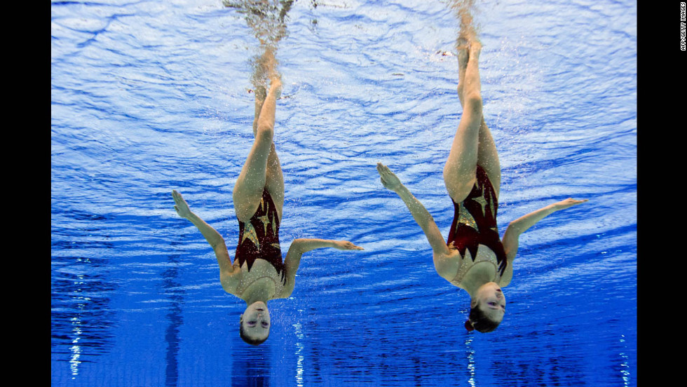 North Korea's Jang Hyang Mi and Jong Yon Hui compete in the duets free routine preliminary round of the synchronized swimming competition.